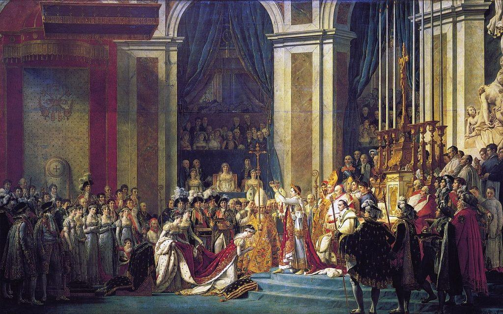 """""""Le Sacre de Napoléon"""" de Jacques-Louis David. Napoléon au centre qui couronne Joséphine de Beauharnais, sa femme. La mère de Napoléon trône au centre."""
